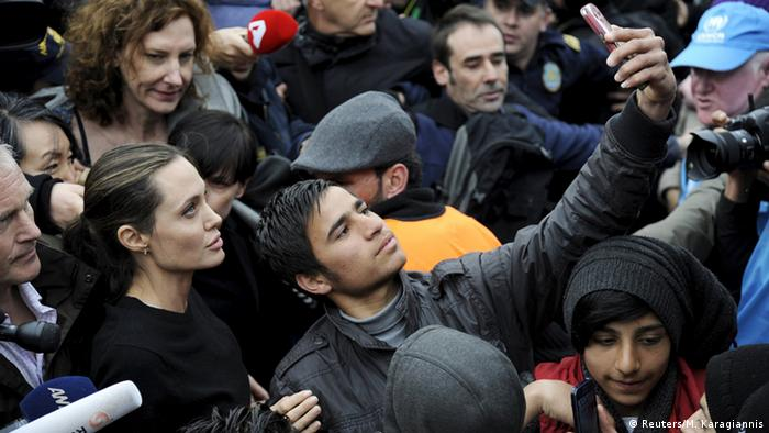 Angelina Jolie with refugees Reuters/M. Karagiannis