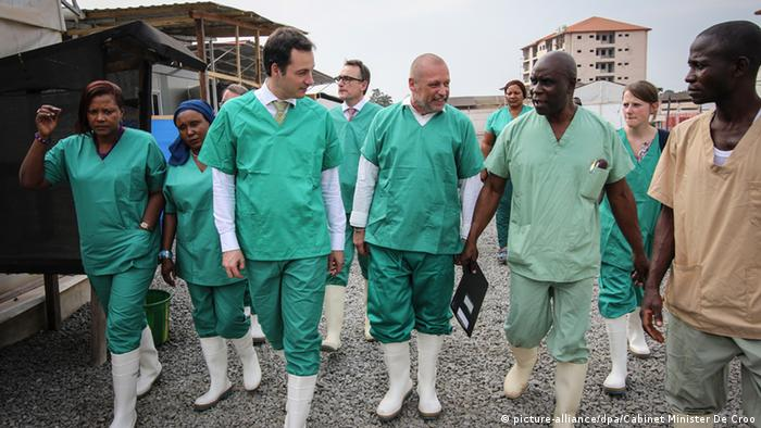 Belgian minister Alexander De Croo (center left) at a 'Doctors without borders' ebola treatment center in Guinea