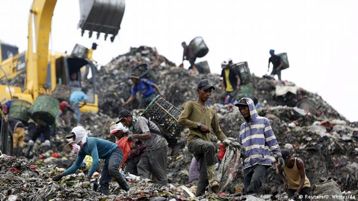 People searching through garbage looking for materials to recycle at at Bantar Gebang landfill in Bekasi, West Java province, Indonesia