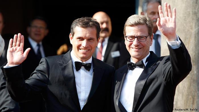 Guido Westerwelle and Michael Mronz waving at camerals at Bayreuth festival in 2012 (Reuters/M. Rehle)