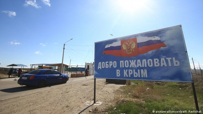 An entrance sign with a message reading Welcome to Crimea at Dzhankoi crossing on the Russian-Ukrainian border.