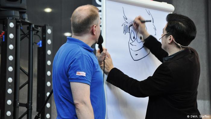 Steffen Volkmer und Marvin Clifford auf der Bühne bei der Comic Con in Leipzig
