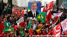 Demonstrators attend a protest in support of Brazil's President Dilma Rousseff and former President Luiz Inacio Lula da Silva, in Sao Paulo, Brazil, Friday, March 18, 2016. Supporters of Silva, who was one of the world's most famous leaders as president from 2003 to 2010, began to gather for rallies in a handful of cities across Brazil, particularly in the industrial south, where the former factory worker has his base. Silva has been tied to a sprawling corruption investigation involving the Brazil oil giant Petrobras. (AP Photo/Andre Penner)