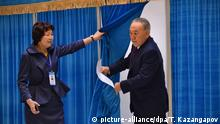 March 20, 2016 (c) picture-alliance/dpa/T. Kazangapov epa05221854 Kazakh President Nursultan Nazarbayev (R) leaves a polling booth after casting his vote during early parliament elections in Astana, Kazakhstan, 20 March 2016. Polling stations across Kazakhstan opened as voters began casting their ballots for early legislative elections in this Central Asian nation. There are 234 hopefuls vying for 98 seats in the 107-seat lower house of Parliament, or Mazhilis, with the remaining nine seats designated by the Assembly of the People of Kazakhstan, a constitutional body made up of representatives from the nation's ethnic groups. EPA/TURAR KAZANGAPOV