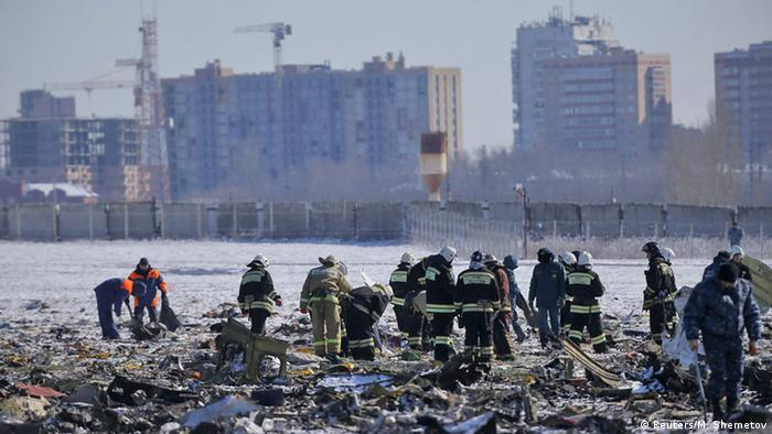 Emergency workers comb the crash site of a Boeing 737-800 in Rostov-on-Don.