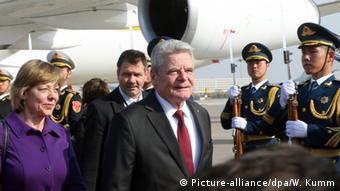 Gauck walks past Chinese honor guards upon his arrival in Beijing.