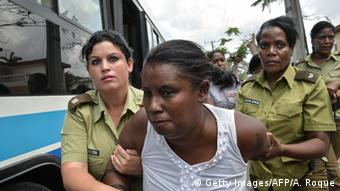 Members of dissident group 'Ladies in White', wives of former political prisoners, are detained during their protest ADALBERTO ROQUE/AFP/Getty Images