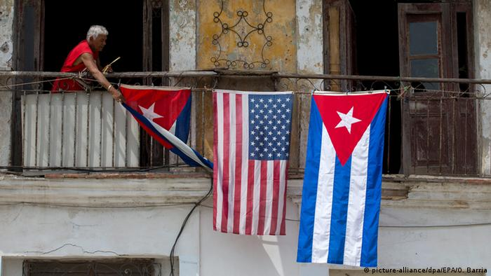 An American flag hangs next to a Cuban one in Havana