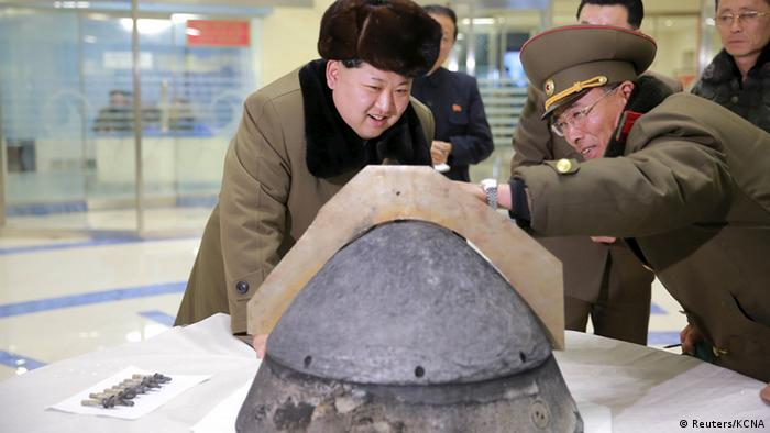 North Korean leader Kim Jong Un looks at a rocket warhead tip after a simulated test of atmospheric re-entry of a ballistic missile, at an unidentified location in this undated photo released by North Korea's Korean Central News Agency (KCNA) in Pyongyang on March 15, 2016 (Photo: REUTERS/KCNA)