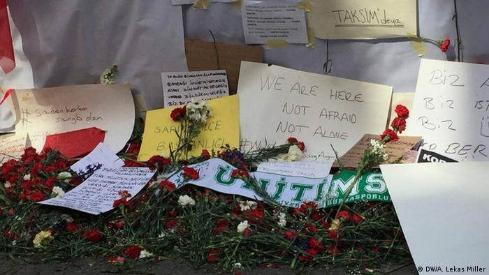 Signs in English, French, Hebrew and Turkish in at the memorial on the site of the suicide bombing