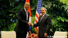 U.S. President Barack Obama and Cuba's President Raul Castro shake hands during their first meeting on the second day of Obama's visit to Cuba, in Havana March 21, 2016. REUTERS/Carlos Barria Reuters/C.Barria