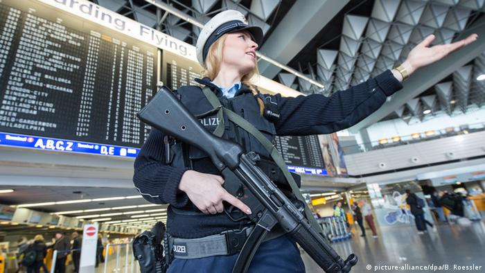 A German police officer brandishes an assault rifle