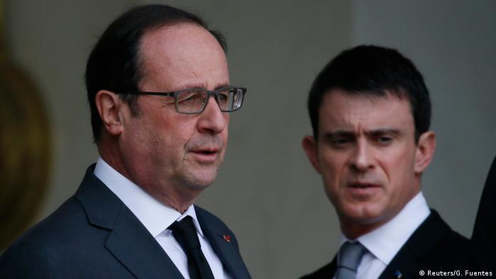 French president Francois Hollande anmd Prime Minister Manuel Valls (R)