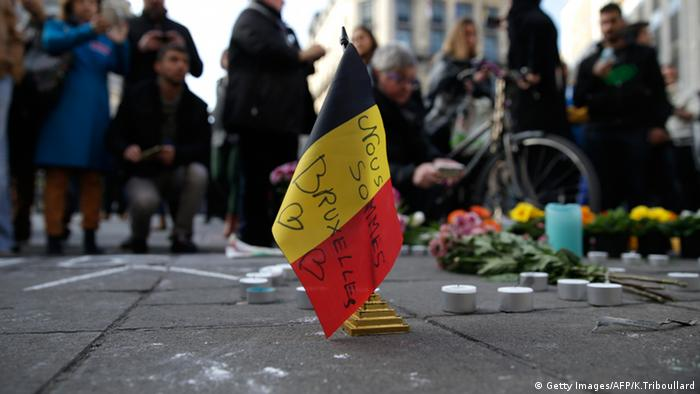 A small Belgian flag adorns a memorial to victims of the Brussels attacks