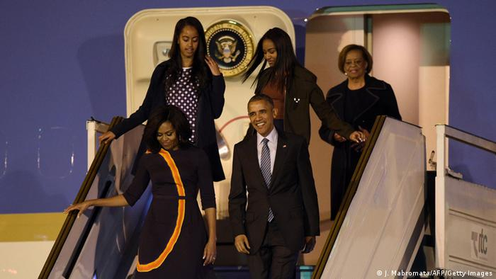 President Barack Obama and First Lady Michelle Obama arrive in Argentina with their daughters