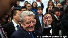German President Joachim Gauck talks with students after his speech at Tongji University in Shanghai on March 23, 2016. / AFP / JOHANNES EISELE (Photo credit should read J. Eisele/AFP/Getty Images)