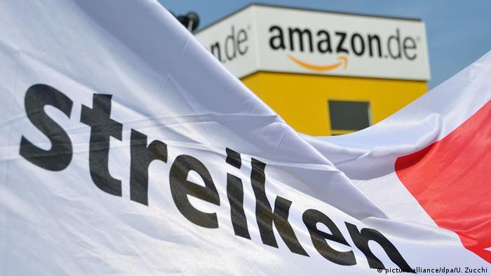 The Amazon logo with a strike flag