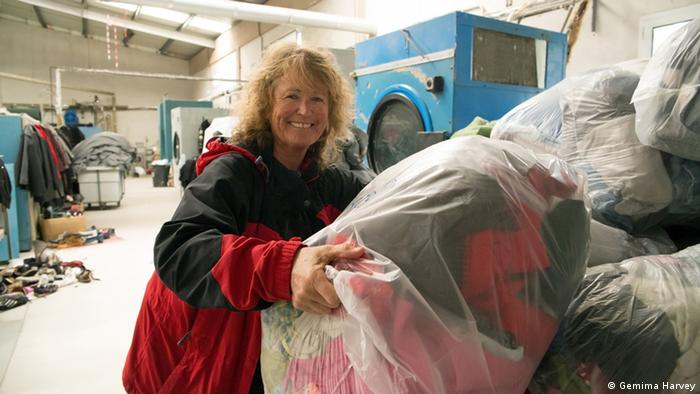 woman next to bags of laundry copyright: Gemima Harvey