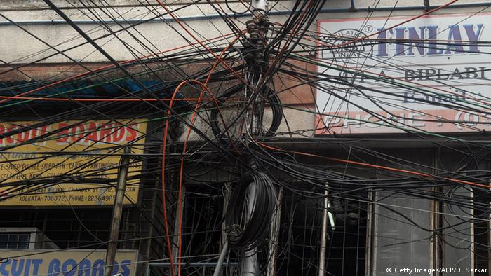 An electric pole is wrapped in a tangle of wires in Kolkata (Photo: Getty Images/AFP/D. Sarkar)