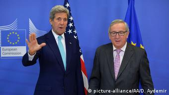 Secretary John Kerry motions with hsi right hand during a meeting with EC President Jean-Claude Juncker.