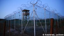 21.03.2016 Chain link fence and concertina wire surrounds a deserted guard tower within Joint Task Force Guantanamo's Camp Delta at the U.S. Naval Base in Guantanamo Bay, Cuba March 21, 2016 (c) Reuters/L. Jackson