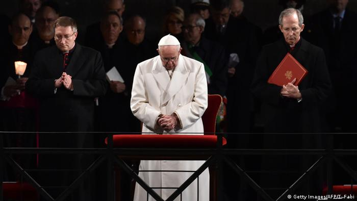 Pope Francis prays during the via Crucis (The Way of the Cross) in the Vatican on Good Friday Copyright: Getty Images/AFP/T. Fabi