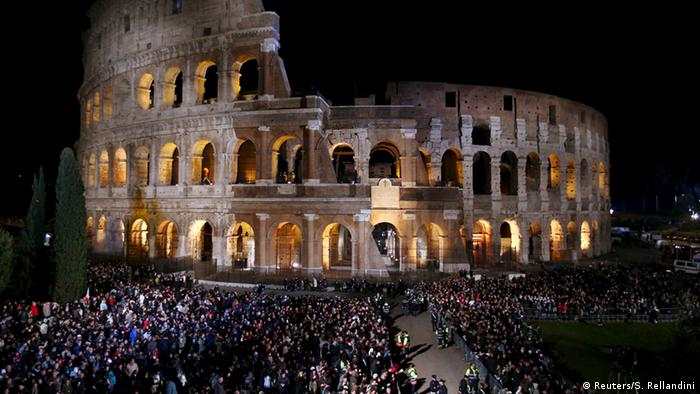 People amass around the Colosseum in Rome