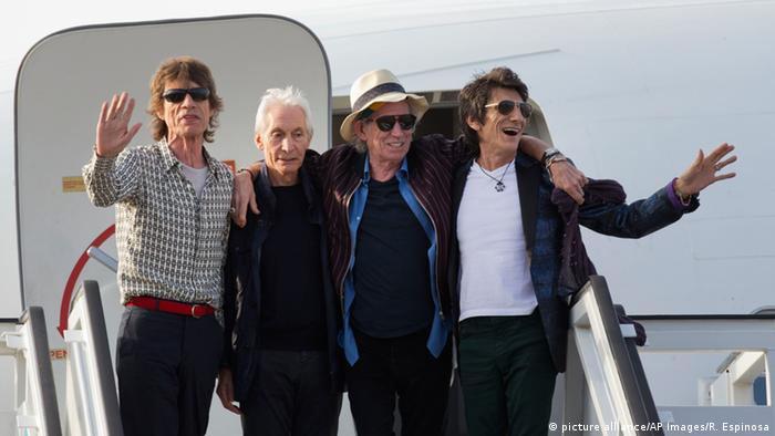 The Rolling Stones posing for photos from a plane