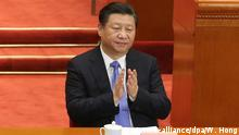 Chinese President Xi Jinping claps during the closing of the Fourth Session of the 12th National Committee of the Chinese People's Political Consultative Conference (CPPCC) at the Great Hall of the People (GHOP) in Beijing, China, 14 March 2016