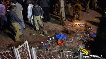 Pakistani rescuers and officials gather at a bomb blast site in Lahore on March 27, 2016 (Photo: ARIF ALI/AFP/Getty Images)