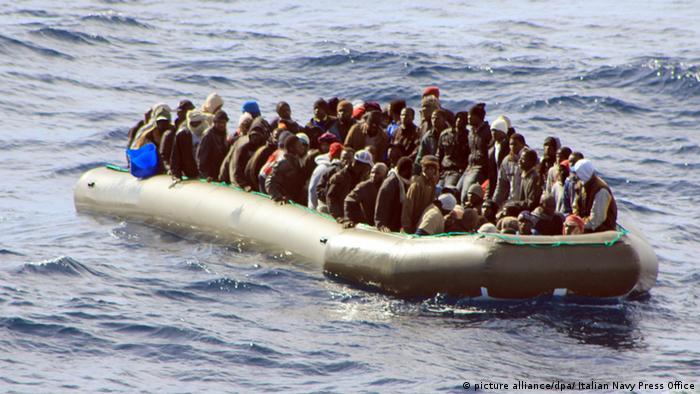 Migrants aboard a boat off the Italian island of Lampedusa