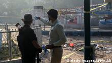 March 28, 2016. Pakistani security officials examine the cordoned-off site of the March 27 suicide bombing, in Lahore on March 28, 2016. The toll from a suicide blast in Pakistan's Lahore rose to 69, officials said on March 28, as authorities hunted for the savage inhumans behind the attack in a park packed with Christian families celebrating Easter Sunday. More than 200 people were injured, many of them children, when explosives packed with ball bearings ripped through crowds near a children's play area in the park in Lahore, leaving dozens dead or bloodied. / AFP / ARIF ALI (Photo credit should read ARIF ALI/AFP/Getty Images) © Getty Images/AFP/A.Ali