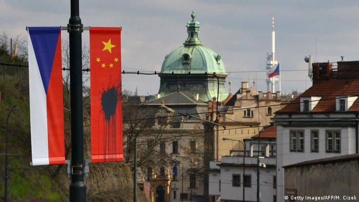 A Czech and Chinese flag splattered with a black substance ahead of a visit to Prague by Chinese President Xi Jinping in 2016