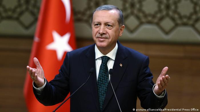 Erdogan speaking at a podium