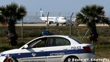29.03.2016 Police stand guard at Larnaca Airport near a hijacked Egyptair Airbus A320 , March 29, 2016. REUTERS/Yiannis Kourtoglou Copyright: Reuters/Y. Kourtoglou