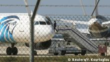 29.03.2016 An official boards a hijacked Egyptair A320 Airbus at Larnaca Airport in Larnaca, Cyprus, March 29, 2016. REUTERS/Yiannis Kourtoglou Copyright: Reuters/Y. Kourtoglou