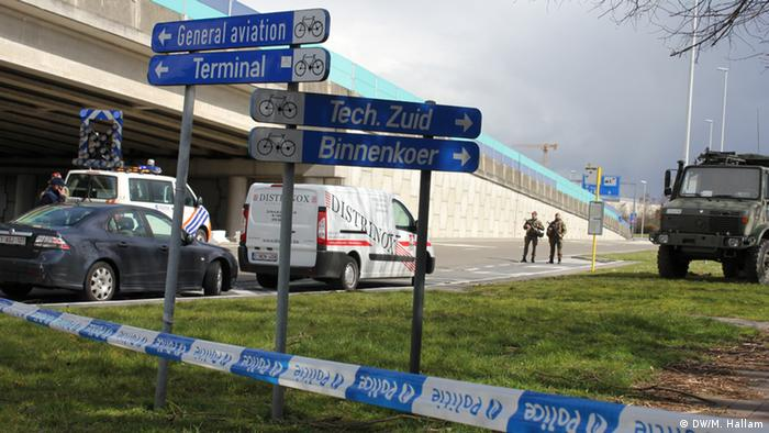 Police and military patrol the road approaching Brussels International Airport in Zavantem, Tuesday March 29, 2016. The airport began test-runs on the Tuesday, with a view to a partial reopening on Wednesday.