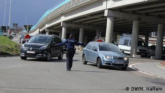 A police officer directs traffic at a Zavantem roundabout, as part of the detail looking after Brussels' airport.