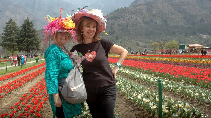 Foreign tourists pose for a life time memorable photograph in the Asia's largest Tulip Garden on the foothills of Zabarwan near Dal Lake in Srinagar
