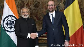 Belgian Prime Minister Charles Michel (r.) and his Indian counterpart Narendra Modi shake hands, in Brussels, March 30, 2016.