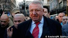 24.03.2016 Serbian ultra-nationalist leader Vojislav Seselj surrounded by his supporters arrives for an anti-government rally in Belgrade March 24, 2016. Copyright: Reuters/M. Djurica