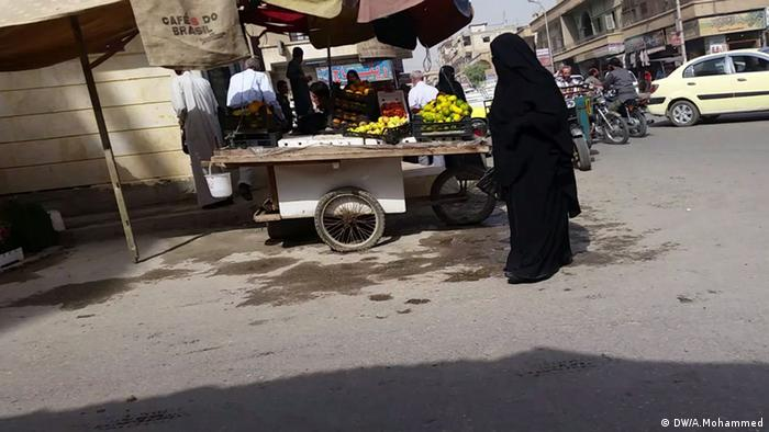 A picture of a woman wearing niqab in Raqqa
