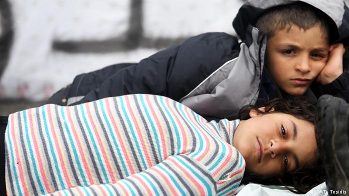 two children lying next to each other copyright: Dimitris Tosidis