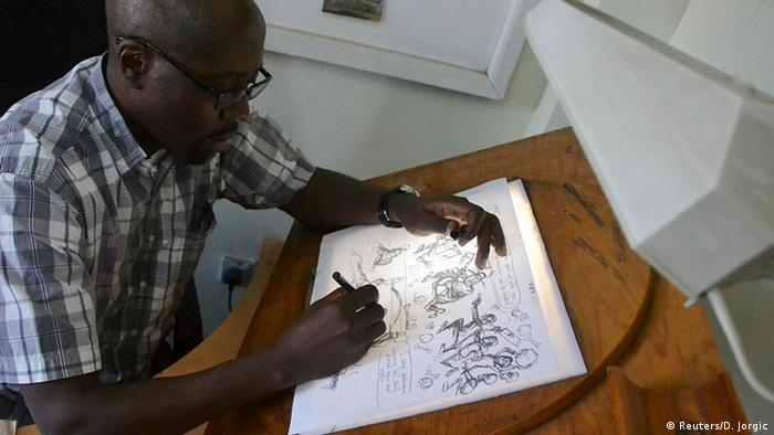 Kenyan cartoonist Godfrey Mwampembwa (Gado) working on a new cartoon © Reuters/D. Jorgic