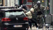 March 18, 2016 In this framegrab taken from VTM, something appears to drop from inside the trouser leg of Salah Abdeslam, centre, as he is arrested by police and bundled into a police vehicle during a raid in the Molenbeek neighborhood of Brussels, Belgium, Friday March 18, 2016. After an intense four-month manhunt across Europe and beyond, police on Friday captured Salah Abdeslam, the top suspect in last year's deadly Paris attacks, in the same Brussels neighborhood where he grew up. (VTM via AP) BELGIUM OUT (c) picture-alliance/AP Photo/VTM