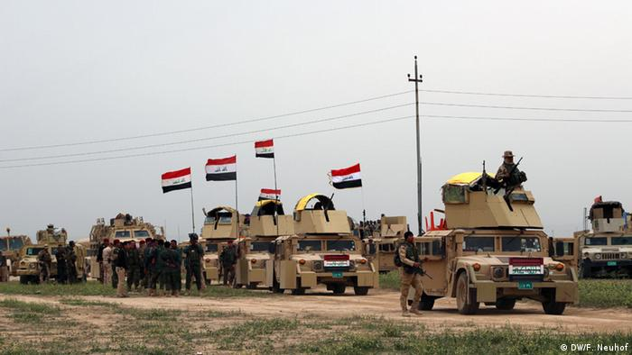 A column of armored cars gets ready to advance towards Nasr village