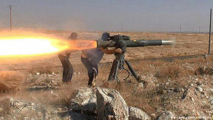 IS militants fire an anti-tank missile