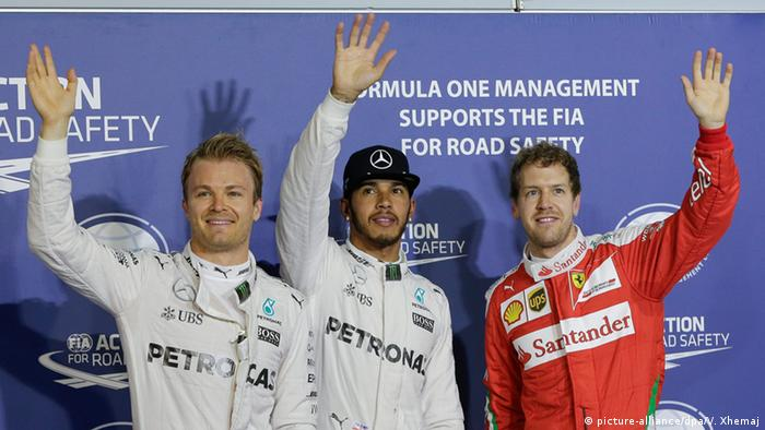 Ferrari's Sebastian Vettel with Mercedes drivers Nico Rosberg and Lewis Hamilton (picture-alliance/dpa/V. Xhemaj)