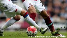 West Ham United's Dimitri Payet, right, in close action against Crystal Palace's Joel Ward during their English Premier League soccer match at Upton Park, London, Saturday April 2, 2016. (Steve Paston / PA via AP) Copyright: picture-alliance/AP Photo/S. Paston