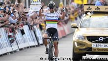 03.04.2016 Flanderntour Slovakian world champion Peter Sagan of Tinkoff crosses the finish line to win the 100th edition of the 'Ronde van Vlaanderen - Tour des Flandres - Tour of Flanders' one day cycling race, 255km from Zedelgem to Oudenaarde, Sunday 03 April 2016 Copyright: picture-alliance/dpa/BELGA/Y. Jansens